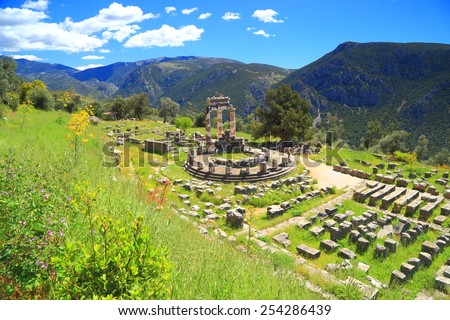 Temple dedicated to goddess Athena in a green valley, Delphi, Greece - stock photo