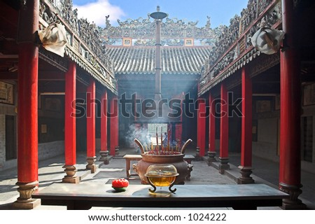 Temple filled with smoke from burning incenses. - stock photo