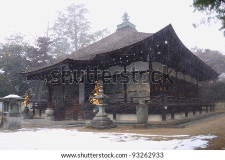 Temple in Kyoto during snowfall (Japan) - stock photo