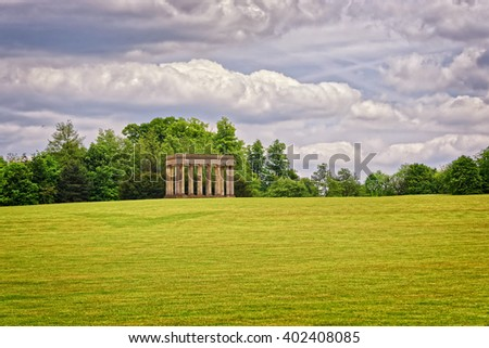 Temple of Concord in Park of Audley End House in Essex in England. It is a medieval county house. Now it is under protection of the English Heritage. - stock photo