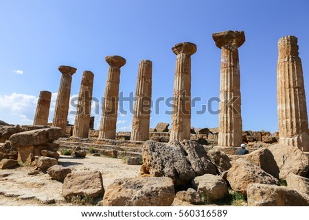 Temple of Heracles at the archaeological site at Agrigento, in Sicily, Italy on a sunny afternoon with clouds. Part of the UNESCO World Heritage List since 1997.