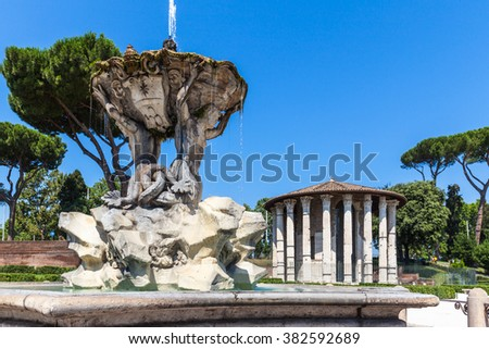 Temple of Hercules Victor and the fountain, ancient edifice located in Piazza Bocca della Verita in Rome Italy. Near the famous Santa Maria in Cosmedin with mouth of truth. - stock photo