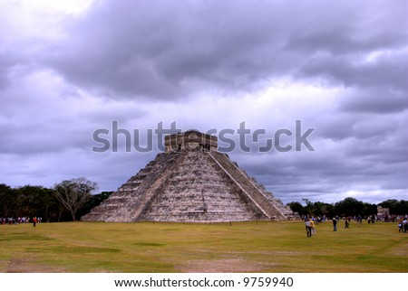 Temple of Kukulcan at the Chichen Itza, Mexico,  on a cloudy day. - stock photo