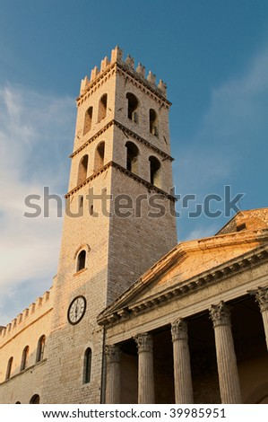 Temple of Minerva/Church of Santa Maria and the Municipal Tower, Assisi in evening sunlight - stock photo