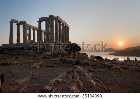 temple of Poseidon on coast of cape Sounion at the sunset - stock photo