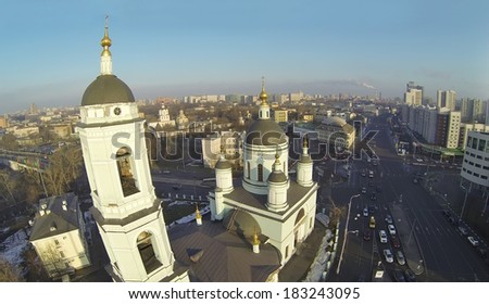 Temple of St. Sergius Radonezhsky (Trinity) in Rogozhskaya Sloboda and Andronievskaya square at winter, Moscow, Russia. Aerial view - stock photo