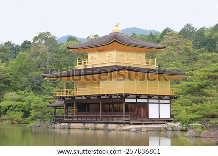 Temple of the Golden Pavilion or Kinkaku-ji or Rokuon-ji, a famous Zen Buddhist Temple, is a National Special Historic Site in Kyoto, Japan. - stock photo