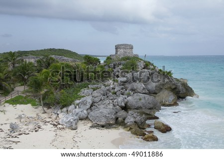 Temple of the Winds God and rocky coast at Mayan ruin site in Tulum Mexico - stock photo