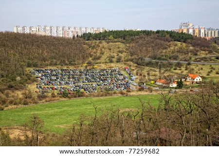 temporary car parking on the field - stock photo