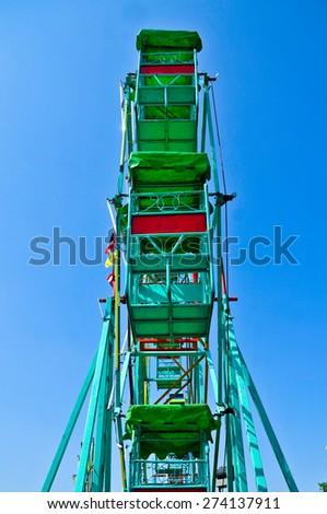 Temporary Ferris wheel on blue sky, Thailand - stock photo