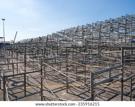 Temporary grandstand seats under construction - stock photo