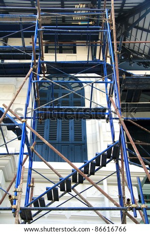 Temporary metal Scaffolding outside the building for workers to re paint the exterior