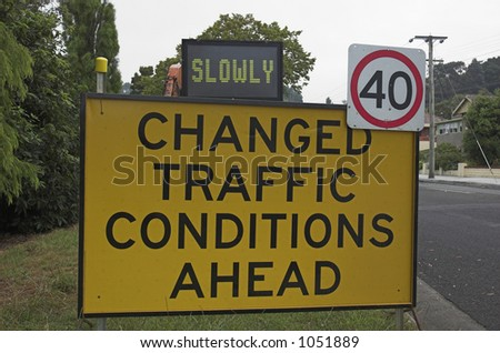 Temporary warning sign advising drivers to go slowly due to changed traffic conditions.