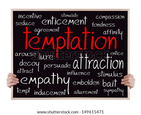 temptation and other related words handwritten on blackboard with hands - stock photo