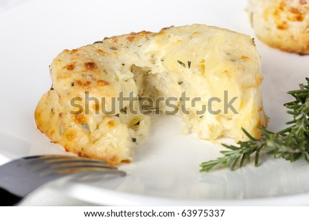 Tempting potato and cheese souffle with rosemary.