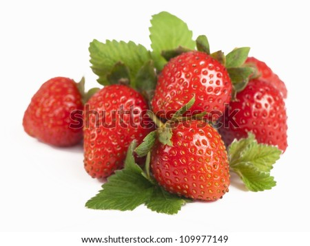 Tempting strawberries with leaves. Isolated on a white background - stock photo
