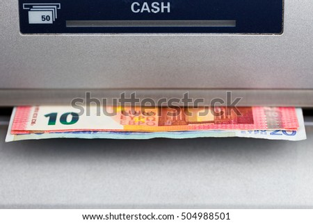Ten and Twenty Euro banknotes dispensed from an ATM in Europe