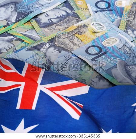 Ten Australian Dollars Banknotes with Australian Flag. - stock photo