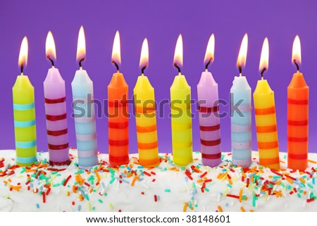 Ten birthday candles on lilac background