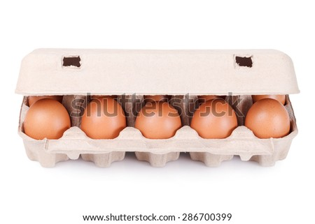 Ten brown eggs in a carton package - stock photo