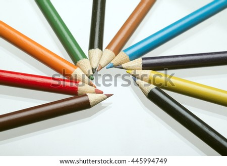ten colored pastels mirrored on white background  - stock photo