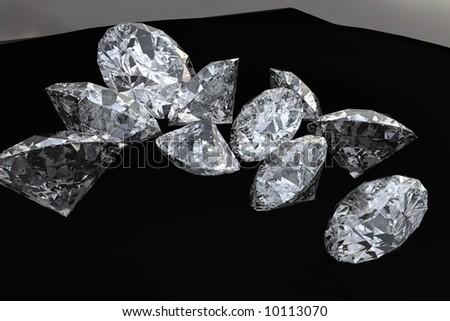 Ten cut diamond stones on black cloth - stock photo