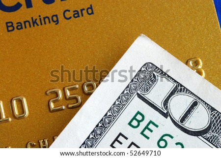Ten dollar bill and a credit card concepts of finance - stock photo
