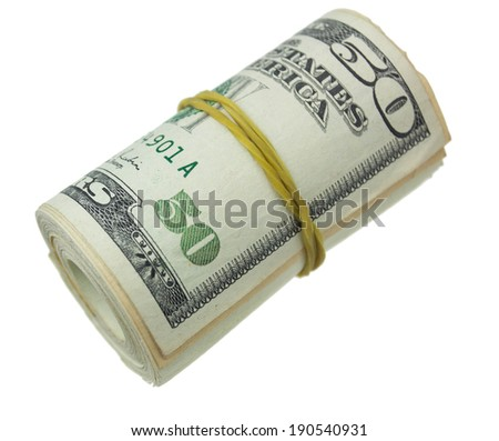 Ten dollars rolled up with rubberband isolated on white