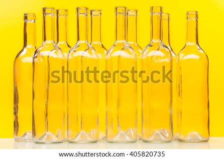 Ten empty glass bottles standing in a row - stock photo