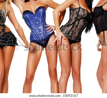 Ten female bodies in corsets, isolated on a white background, please see some of my other parts of a body images - stock photo