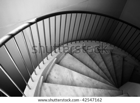 Ten footstep on spiral ladder - stock photo