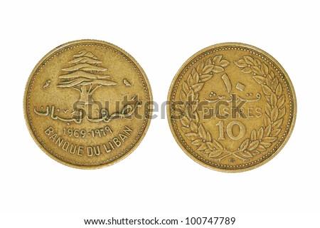 Ten lebanese piastres monet taken closeup isolated on white background. - stock photo