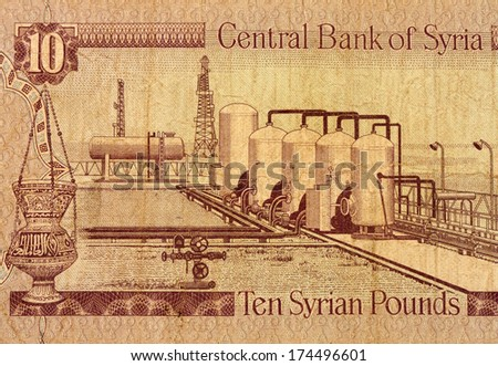 Ten Syrian pounds banknote fragment used macro - stock photo