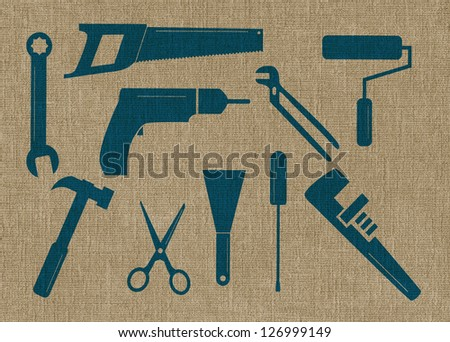 Ten tool shapes on a textured background - stock photo