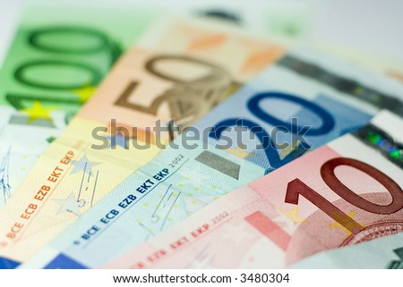 Ten, Twenty, Fifty, and One Hundred Euro banknotes with shallow depth of field and focus on the 10.