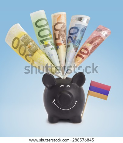 Ten,twenty,fifty,one hundred and a 200 Euro banknote in a smiling piggybank of Armenia.(series) - stock photo