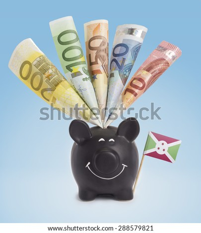 Ten,twenty,fifty,one hundred and a 200 Euro banknote in a smiling piggybank of Burundi.(series) - stock photo