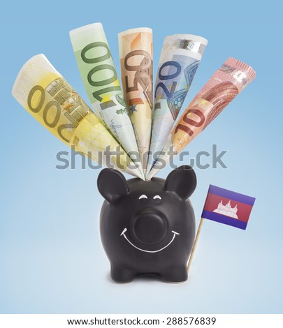 Ten,twenty,fifty,one hundred and a 200 Euro banknote in a smiling piggybank of Cambodia.(series) - stock photo