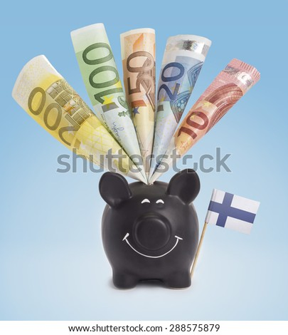Ten,twenty,fifty,one hundred and a 200 Euro banknote in a smiling piggybank of Finland.(series) - stock photo