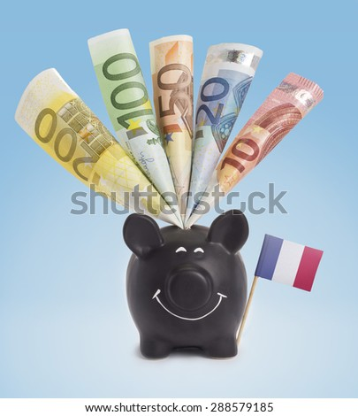 Ten,twenty,fifty,one hundred and a 200 Euro banknote in a smiling piggybank of French Guiana.(series) - stock photo