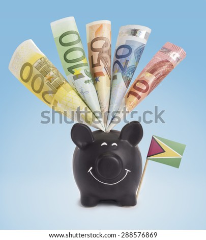 Ten,twenty,fifty,one hundred and a 200 Euro banknote in a smiling piggybank of Guyana.(series) - stock photo