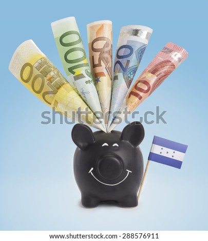 Ten,twenty,fifty,one hundred and a 200 Euro banknote in a smiling piggybank of Honduras.(series) - stock photo