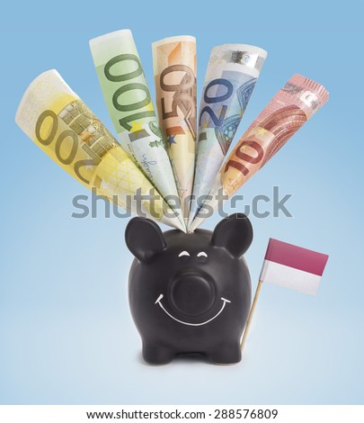 Ten,twenty,fifty,one hundred and a 200 Euro banknote in a smiling piggybank of Indonesia.(series) - stock photo
