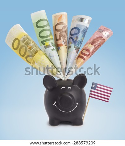 Ten,twenty,fifty,one hundred and a 200 Euro banknote in a smiling piggybank of Liberia.(series) - stock photo