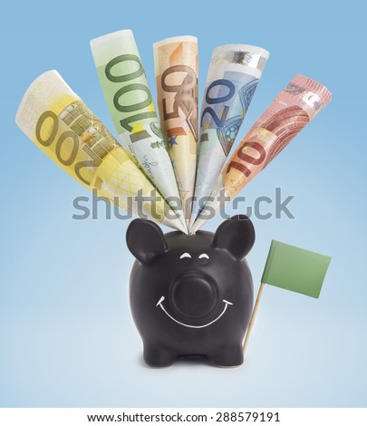 Ten,twenty,fifty,one hundred and a 200 Euro banknote in a smiling piggybank of Libya.(series) - stock photo