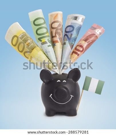 Ten,twenty,fifty,one hundred and a 200 Euro banknote in a smiling piggybank of Nigeria.(series) - stock photo