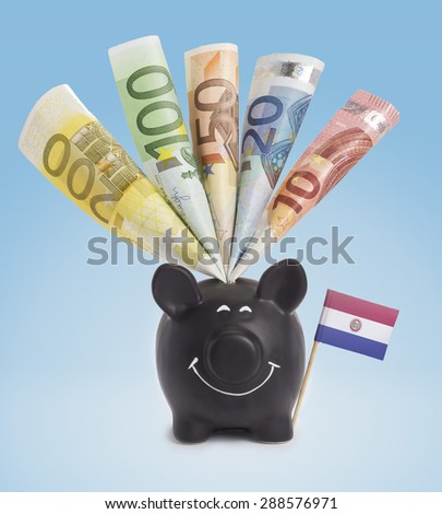 Ten,twenty,fifty,one hundred and a 200 Euro banknote in a smiling piggybank of Paraguay.(series) - stock photo
