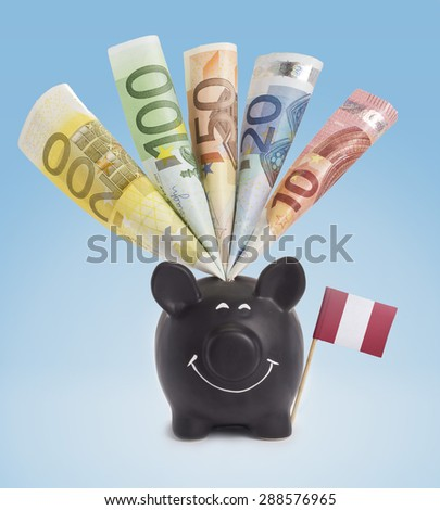 Ten,twenty,fifty,one hundred and a 200 Euro banknote in a smiling piggybank of Peru.(series) - stock photo