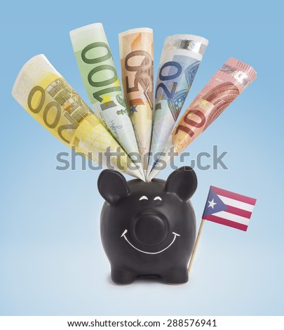 Ten,twenty,fifty,one hundred and a 200 Euro banknote in a smiling piggybank of Puerto Rico.(series) - stock photo