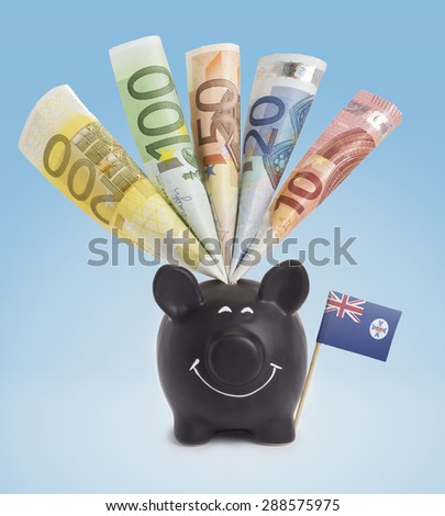 Ten,twenty,fifty,one hundred and a 200 Euro banknote in a smiling piggybank of Queensland.(series) - stock photo